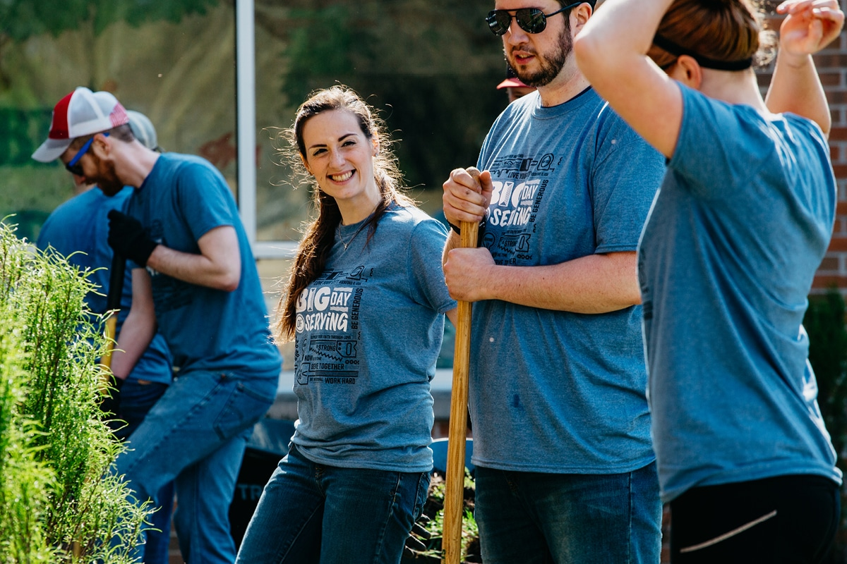 Young adults helping landscape during the Big Day of Serving event